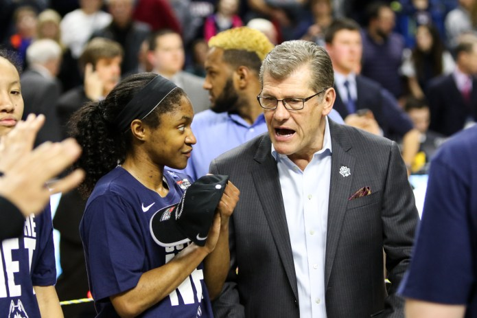UConn freshman Crystal Dangerfield and head coach Geno Auriemma chat during the postgame celebration. (Jackson Haigis/The Daily Campus)