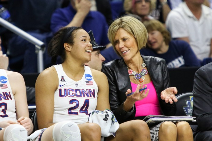 UConn's Napheesa Collier and assistant coach Chris Dailey share a laugh in the fourth quarter of the Huskies' win. (Jackson Haigis/The Daily Campus)
