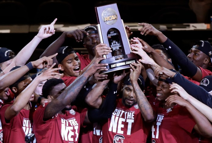 In this Sunday, March 26, 2017, file photo, South Carolina players celebrate after beating Florida 77-70 in the East Regional championship game of the NCAA men's college basketball tournament in New York. (Frank Franklin II, File/AP)