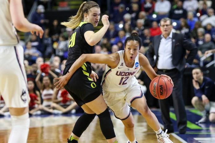 UConn senior guard Saniya Chong drives past Oregon freshman Sabrina Ionescu in the Huskies' 90-52 win in the Elite 8 on March 27, 2017.(Jackson Haigis/The Daily Campus)