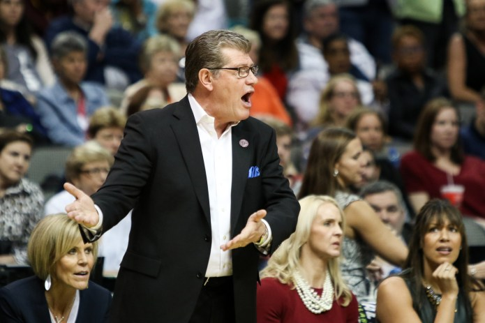 UConn coach Geno Auriemma and his coaching staff react to a foul call in the first half of the game.