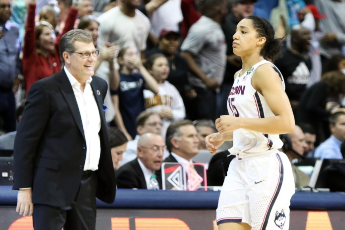 """UConn's Gabby Williams holds back tears after the game while head coach Geno Auriemma cracks a smile. """"I knew this was coming at some point,"""" Auriemma remarked in the post-game press conference."""