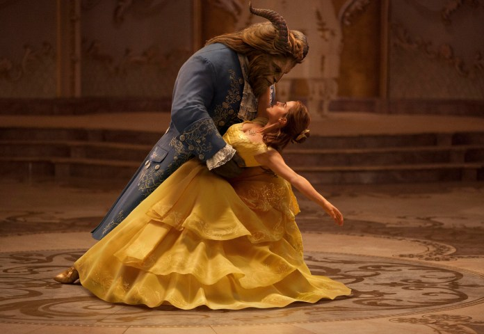 """This image released by Disney shows Dan Stevens as The Beast, left, and Emma Watson as Belle in a live-action adaptation of the animated classic """"Beauty and the Beast."""" (Disney/AP Exchange)"""