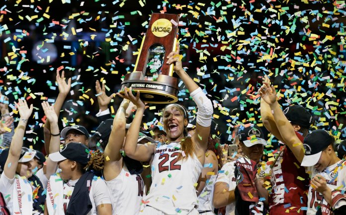 South Carolina forward A'ja Wilson (22) holds the trophy as she and her teammates celebrate a win over Mississippi State in the final of NCAA women's Final Four college basketball tournament, Sunday, April 2, 2017, in Dallas.South Carolina won 67-55. (AP Photo/Tony Gutierrez)
