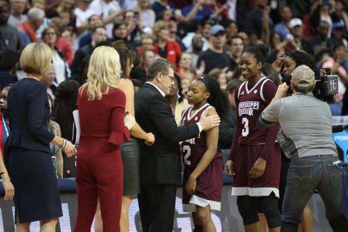 UConn coach Geno Auriemma congratulates Mississippi State's Morgan Williams after the Huskies were upset Friday, March 31. (Jackson Haigis/The Daily Campus)