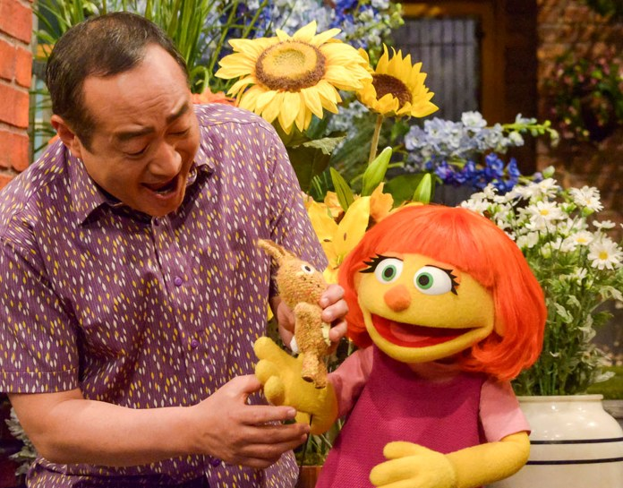 """This image released by Sesame Workshop shows Julia, a new autistic muppet character debuting on the 47th Season of """"Sesame Street,"""" on April 10, 2017, on both PBS and HBO. (Zach Hyman/AP)"""