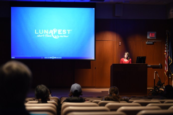 Students and faculty watch films from the annual LUNAFEAST film festival in Konover Auditorium on Thursday,April 6th. LUNAFEST is a traveling film festival of award-winning short films by, for and about women. (Zhelun Lang/The Daily Campus)