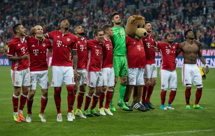 Bayern's players celebrate after the German Bundesliga soccer match between FC Bayern Munich and Borussia Dortmund in Munich, Germany, Saturday, April 8, 2017.Munich defeated Dortmund by 4-1. (Sven Hoppe/dpa via AP)