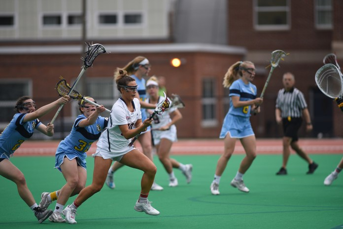 Pictured is UConn sophomore, Grace Nolan (number 10) vs Marquette opponents Wednesday April 12. (Charlotte Lao/ The Daily Campus)