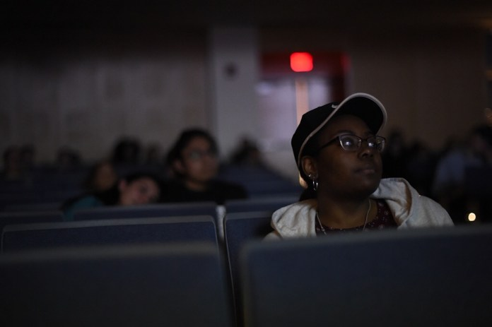 Students watch the Clinica de Migrantes: Life, Liberty and the Pursuit of Happiness in the Student Union Theater on April 13, 2017. (Jason Jiang/The Daily Campus)