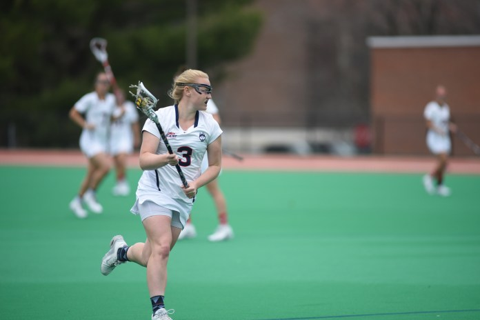 Senior attack Jacqueline Jordan looks for an open passing lane during the Huskies 17-14 victory over Marquette on April 12, 2017 at the Sherman Family Sports Complex. Jordan scored seven points. (Charlotte Lao/The Daily Campus)