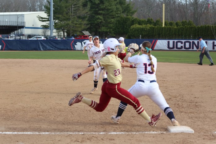UConn first baseman Carli Culter (13) attempts to force an out on Boston College's Lexi DiEmmanuele (23) during the Huskies 3-2 victory over the Eagles on April 11, 2017. (Tyler Benton/The Daily Campus)