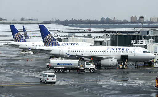 In this Wednesday, March 15, 2017, file photo,United Airlines jets sit on the tarmac at LaGuardia Airport in New York.United Continental Holdings Inc. reports quarterly financial results Monday, April 17, 2017. (AP Photo/Seth Wenig, File)