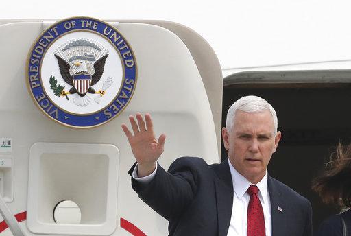 U.S. Vice President Mike Pence waves before leaving for Japan, at Osan Air Base in Pyeongtaek, South Korea, Tuesday, April 18, 2017. (AP Photo/Lee Jin-man)