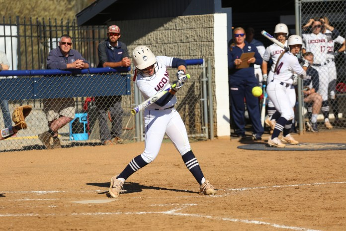 A UConn softball slugger makes contact during the Huskies victory ove UMass Tuesday afternoon at Burrill Family Field. (Tyler Benton/The Daily Campus)