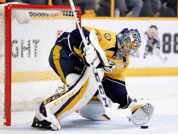 Nashville Predators goalie Pekka Rinne, of Finland, makes a stop against the Chicago Blackhawks during the first period in Game 3 of a first-round NHL hockey playoff series, Monday, April 17, 2017, in Nashville, Tenn. (Mark Humphrey/ AP)