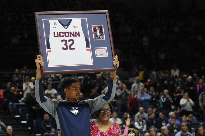UConn men played UCF at Gampel Pavillion on March 6, 2016. Pictured is graduate student Shonn Miller holding his jersey (number 32). (Bailey Wright/ The Daily Campus)
