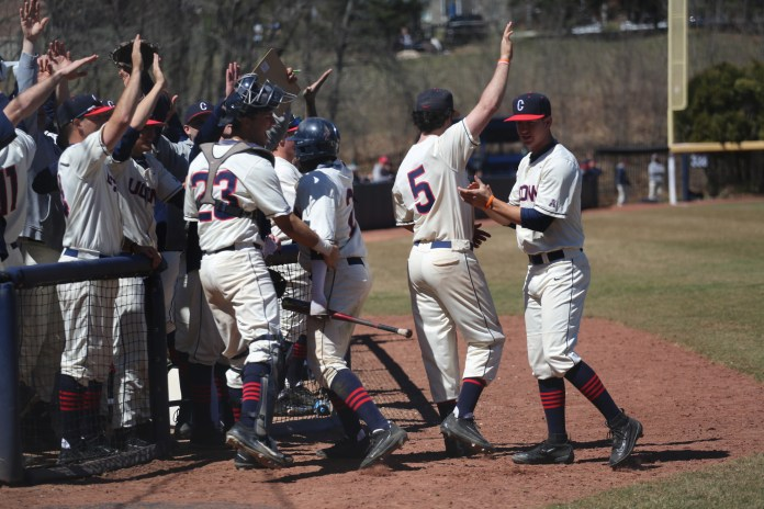 The UConn baseball team celebrates a run during the Huskies 4-0 victory over Memphis on Sunday, April 9, 2017. (Tyler Benton/The Daily Campus)