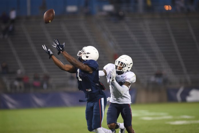 Hergy Mayala (#1) catches a pass in the UConn Spring Game on April 21, 2017, at Rentschler Field in Hartford, CT. (Charlotte Lao/The Daily Campus)