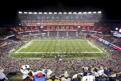 In this Thursday, Sept. 10, 2015, file photo, the New England Patriots fans perform a card stunt commemorating their Super Bowl win before a game against the Pittsburgh Steelers, at Gillette Stadium, in Foxborough, Mass. (AP Photo/Gregory Payan, File)