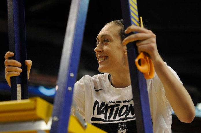 Breanna Stewart cuts down the net after winning the 2016 national championship. During the WBNA off-season, Stewart plays basketball in China. (Bailey Wright/The Daily Campus)