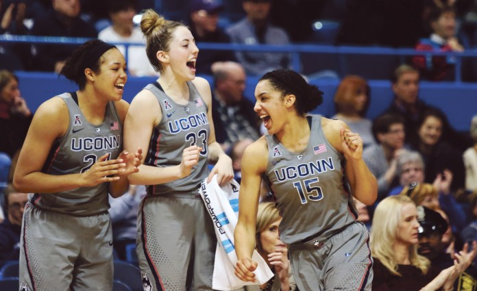 Napheesa Collier (24), Katie Lou Samuelson (#33) and Gabby Williams (#15) celebrate UConn's 102nd win in a row, a 90-45 blowout over Temple. (Jackson Haigis/The Daily Campus)