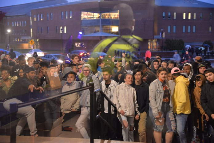 Student's wait in the rain in front of Gampel Pavilion prior to hearing that Lil Uzi would not be coming for the Spring Concert. (Amar Batra/The Daily Campus)
