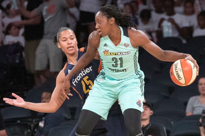 This July 19, 2017, file photo shows New York Liberty center Tina Charles (31) driving to the basket against Connecticut Sun forward Alyssa Thomas (25) during the first half of a WNBA basketball game, at Madison Square Garden in New York.(Mary Altaffer/AP)