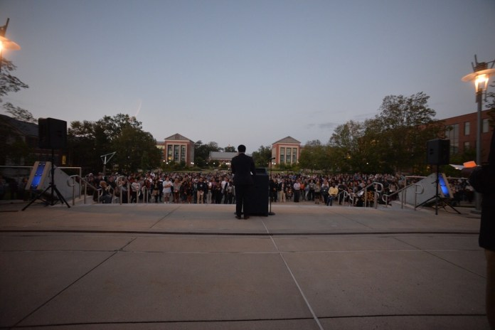 Hundreds gathered in front of the University of Connecticut's Student Union lawn to condemn racism, bigotry and violence seen in Charlottesville, Virginia.(Amar Batra/Daily Campus)