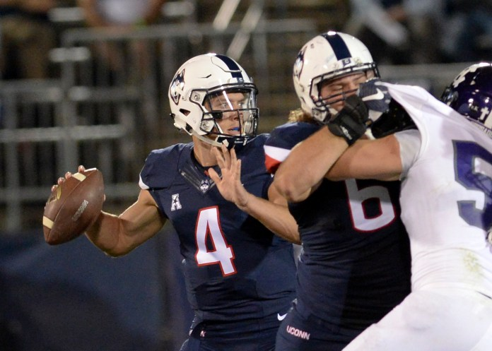 Connecticut quarterback Bryant Shirreffs (4) sets to pass during the fourth quarter against Holy Cross during an NCAA college football game Thursday, Aug. 31, 2017, in East Hartford, Conn. UConn won 27-20. (Stephen Dunn/AP)