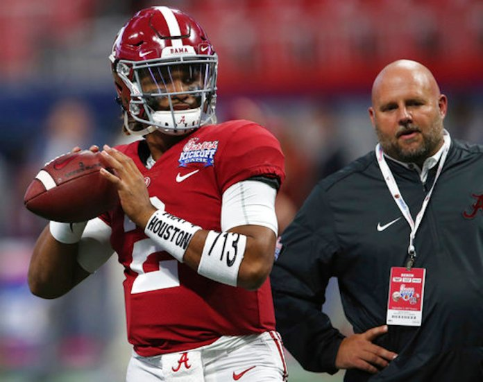 """Alabama quarterback Jalen Hurts (2) warms up wearing arm bands stating """"Pray for Houston,"""" before the first half of an NCAA football game between Alabama and Florida State, Saturday, Sept. 2, 2017, in Atlanta. (AP Photo/John Bazemore)"""
