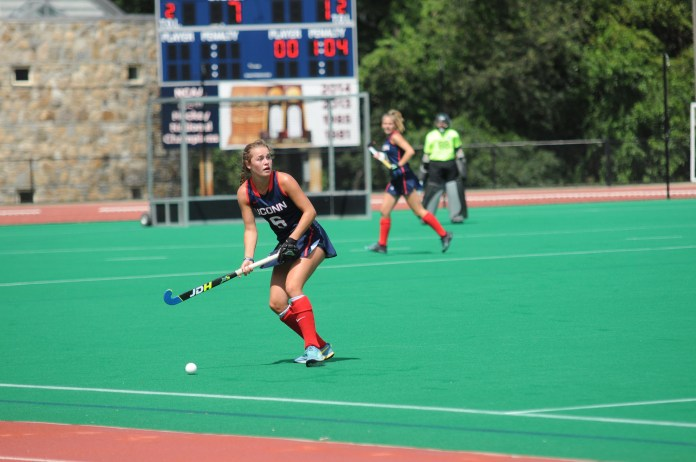 UConn midfielder Barbara van den Hoogen looks for a teammate down field during the Huskies 7-0 victory over Northwestern on Sunday, August 27, 2017 at the Sherman Family Sports Complex. (Olivia Stenger/The Daily Campus)