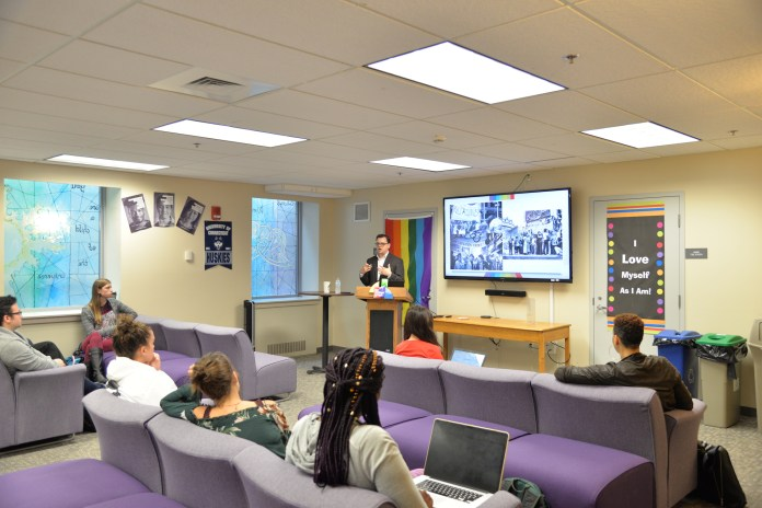 Brian Edwards, the new director of the Rainbow Center, gives a lecture talking about the history of LGBTQ centers in colleges on Wednesday, Sept. 20, 2017 in the Rainbow Center.(Amar Batra/The Daily Campus)
