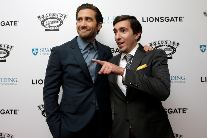 """In this Sept. 12, 2017, file photo, actor Jake Gyllenhaal, left, and Boston Marathon bombing survivor Jeff Bauman, right, arrive on the red carpet at the U.S. premiere of the movie """"Stronger"""" at the Spaulding Rehabilitation Hospital, where Bauman and others who were injured in the 2013 deadly attack were treated in Boston.Gyllenhaal plays Bauman in the film, which opens Friday, Sept. 22, at theaters nationwide. (AP Photo/Steven Senne, File)"""