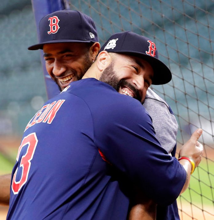 Boston Red Sox's Sandy Leon (3) hugs Eduardo Nunez during practice for baseball's American League Division Series, Wednesday, Oct. 4, 2017, in Houston. The Red Sox will face the Houston Astros Thursday in Game 1 of the ALDS. (AP Photo/David J. Phillip)