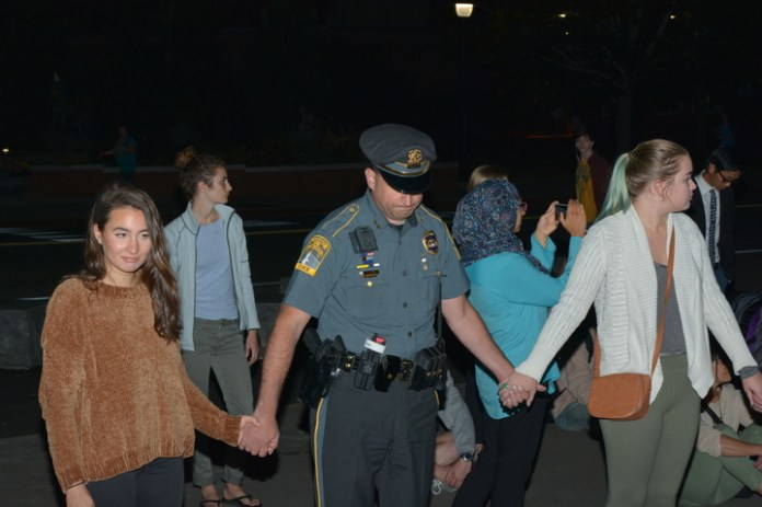 Event attendees included Mansfield Mayor Paul Shapiro, the university's Chief of Police Hans D. Rhynhart, advisor of the Muslim Student Association Reda Ammar, Reverend Ryan Lerner and various other public officials. (Nicholas Hampton/The Daily Campus)