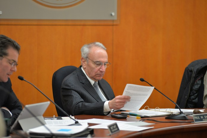 Mansfield Town Council member Paul Shapiro (D) looks at a document during a town council meeting in the Audrey P. Beck Municipal Building in Mansfield, Connecticut. (Amar Batra/The Daily Campus)