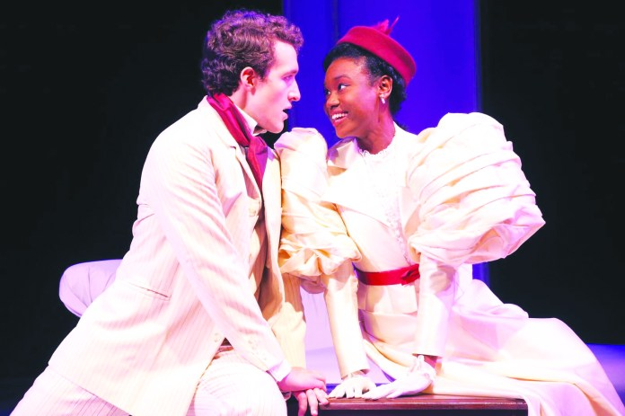 Jack Worthing (played by senior BFA acting candidate Nick Nudler) looks loving at Gwendolen Fairfax (played by senior BFA acting candidate Tabatha Gayle). (Photo Courtesy of Connecticut Repertory Theatre (CRT)