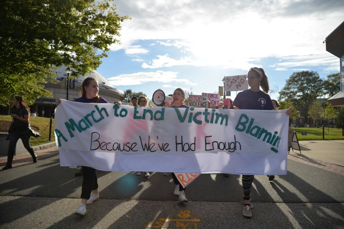 """Students participate in the annual March to end victim blaming on Fairfield Way on Friday, Oct. 13, 2017 in an effort to stamp out rape culture. The event was formally called the """"Slutwalk"""". (Amar Batra/The Daily Campus)"""