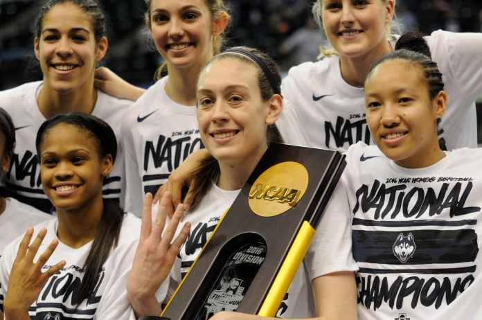 UConn women's basketball pose with their 2016 NCAA Division championship trophy. (File Photo/The Daily Campus)