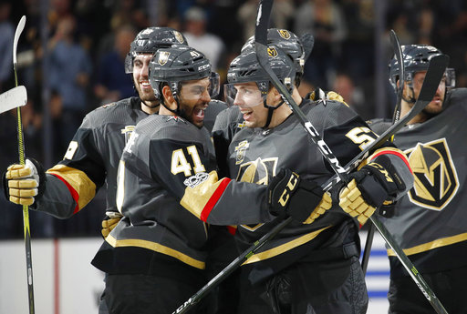 Vegas Golden Knights' Pierre-Edouard Bellemare, left, celebrates with David Perron after Perron made the game-winning goal during overtime of an NHL hockey game against the Buffalo Sabres, Tuesday, Oct. 17, 2017, in Las Vegas.Vegas is 6-1-0 in their first seven games. (AP Photo/John Locher)
