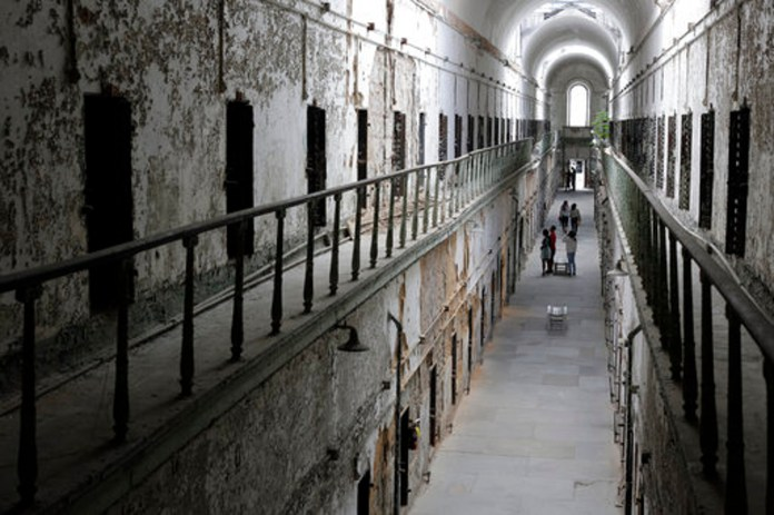 """In this Sept. 27, 2013, file photo, Eastern State Penitentiary in Philadelphia is shown. The penitentiary took in its first inmate in 1829, closed in 1971 and reopened as a museum in 1994. The site is mentioned in the book """"Ghostland: An American History in Haunted Places."""" (AP Photo/Matt Rourke, File)"""