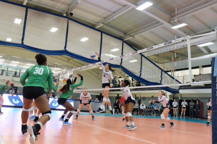 The UConn volleyball team (11-15, 4-10 AAC) split a pair of matches this weekend against Wichita State and Memphis (Jon Sammis/The Daily Campus)
