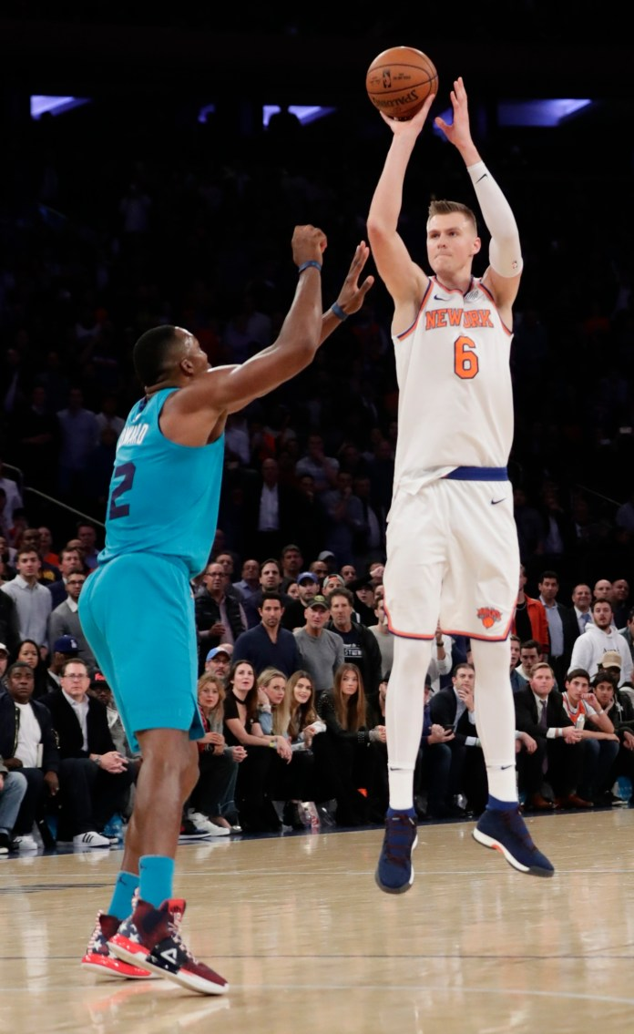 New York Knicks' Kristaps Porzingis (6) shoots over Charlotte Hornets' Dwight Howard (12) during the second half of an NBA basketball game Tuesday, Nov. 7, 2017, in New York. The Knicks won 118-113. (Frank Franklin II/AP)