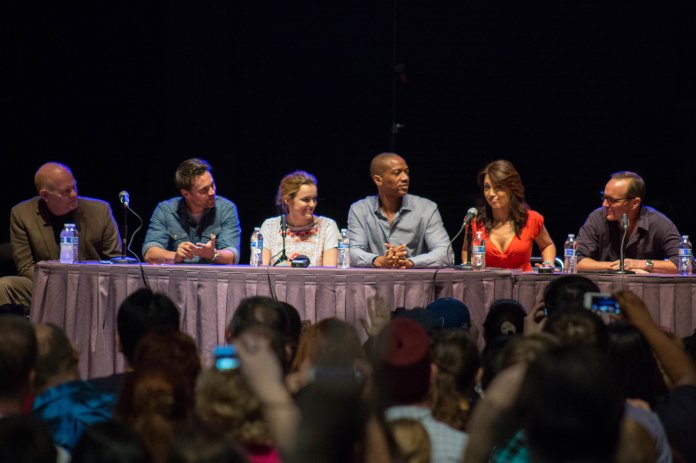 """Agents of S.H.I.E.L.D sit at a panel.The two-hour season five premiere of """"Agents of S.H.I.E.L.D."""" has taken the fan-favorite team of Marvel agents to outer space. (Randall Pugh/Flickr Creative Commons)"""
