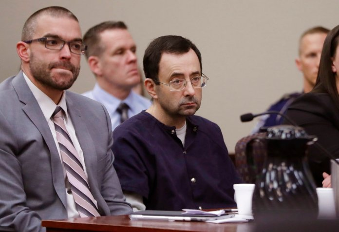 Larry Nassar sits with attorney Matt Newburg during his sentencing hearing Wednesday, Jan. 24, 2018, in Lansing, Mich.(AP Photo/Carlos Osorio)