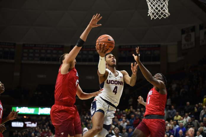 In a tough battle, the Huskies defeat SMU 63-52 on Thursday night in Gampel Pavilion. Christian Vital lead the team with 20 points while Jalen Adams had 18 points. (Charmander Lao/The Daily Campus)