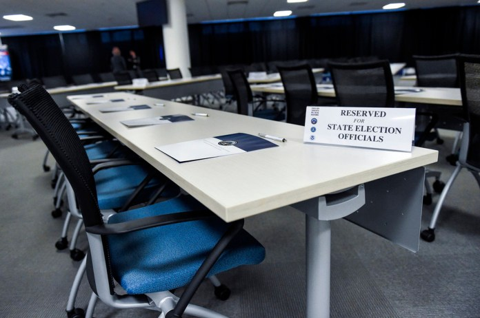 The room in Bethesda, Md., is prepared Friday, Feb. 16, 2018, for state election officials from all 50 states to attend the first of two classified briefings being held to raise awareness of foreign meddling in state election systems. The briefings are being hosted by the national intelligence director's office, the FBI and the Department of Homeland Security to discuss ways to mitigate the threat and improve communication between states and the federal government. The state officials were briefed on the threat from foreign intelligence services, cyber threats and foreign influence operations. The classified briefing was held for officials from the National Association of Secretaries of State, the National Association of State Election Directors and the Election Assistance Commission. (Brian Murphy/Office of the Director of National Intelligence via AP)