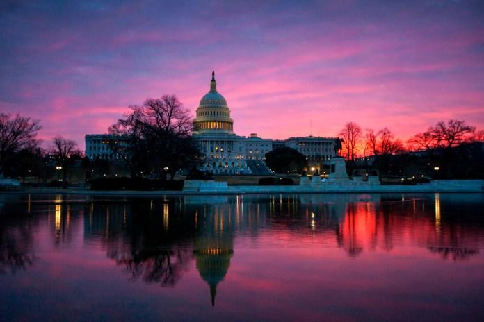 In this Feb. 6, 2018 photo, dawn breaks over the Capitol in Washington.(AP Photo/J. Scott Applewhite)
