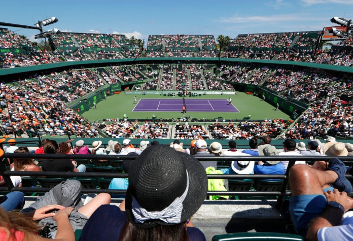 Spectators watch the final between John Isner and Alexander Zverev, of Russia, at the Tennis Center at Carndon Park during the Miami Open tennis tournament, Sunday, April 1, 2018, in Key Biscayne, Fla. (AP Photo/Lynne Sladky)